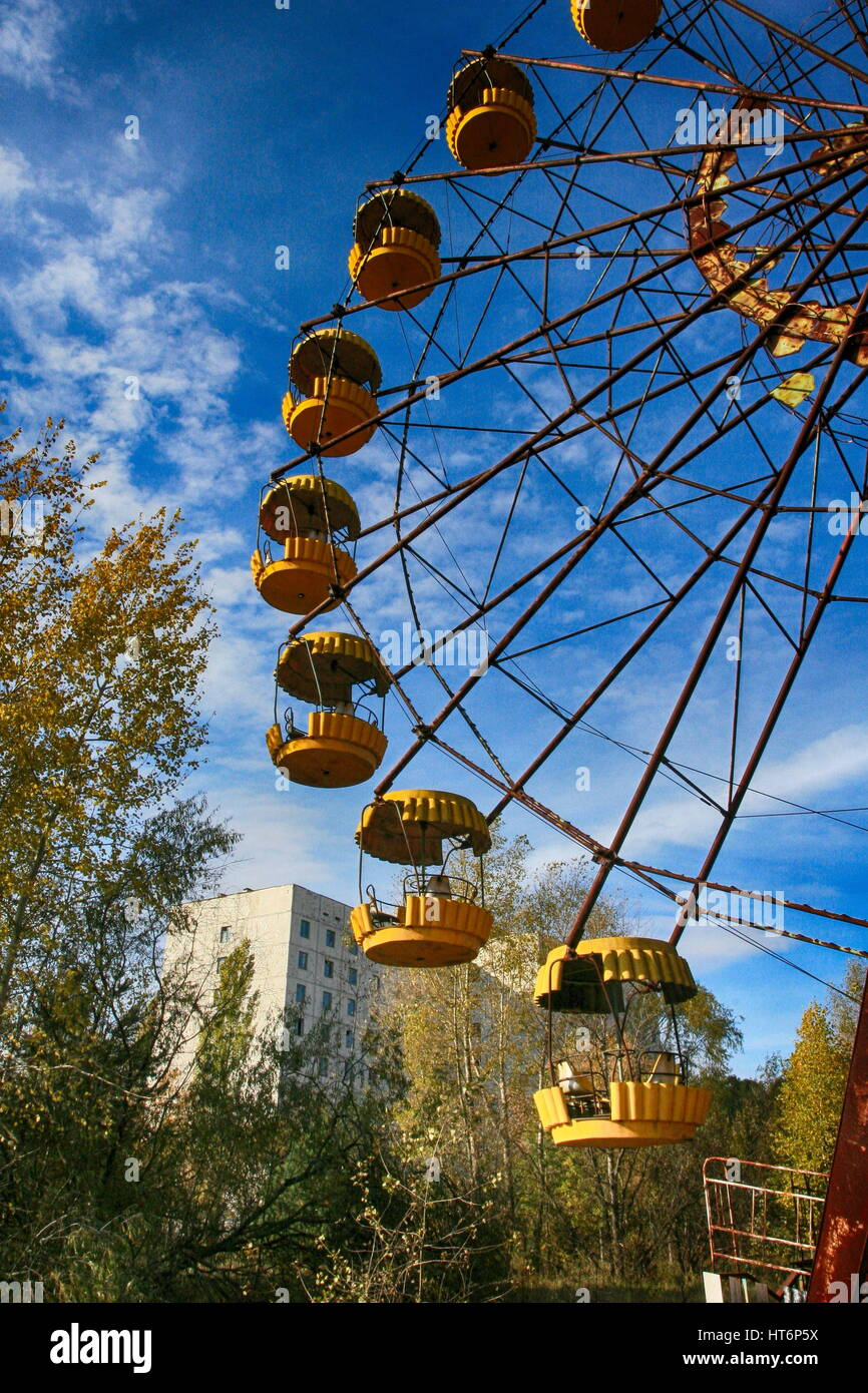 Abandoned amusement park in the Pripyat city, the Chernobyl disaster, the exclusion zone, a ghost town - Stock Image