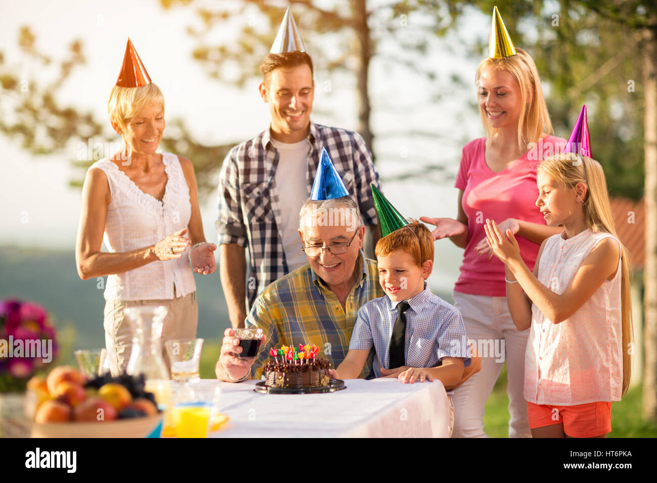 grandfather and grandson on birthday party celebration with family
