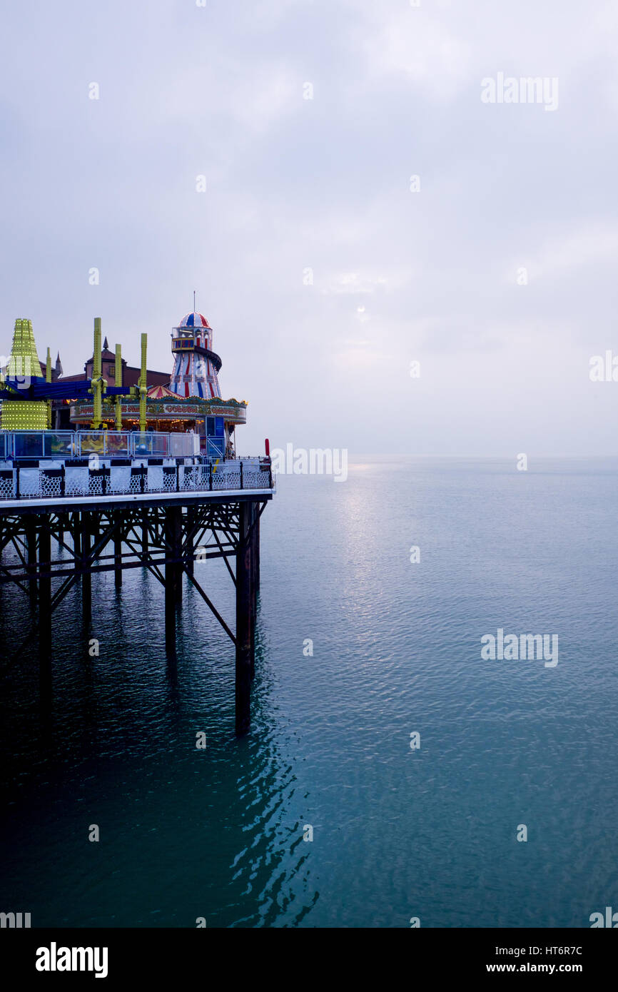 The end of brighton pier with helter scelter and other fair ground rides on the right hand side of the image, the - Stock Image