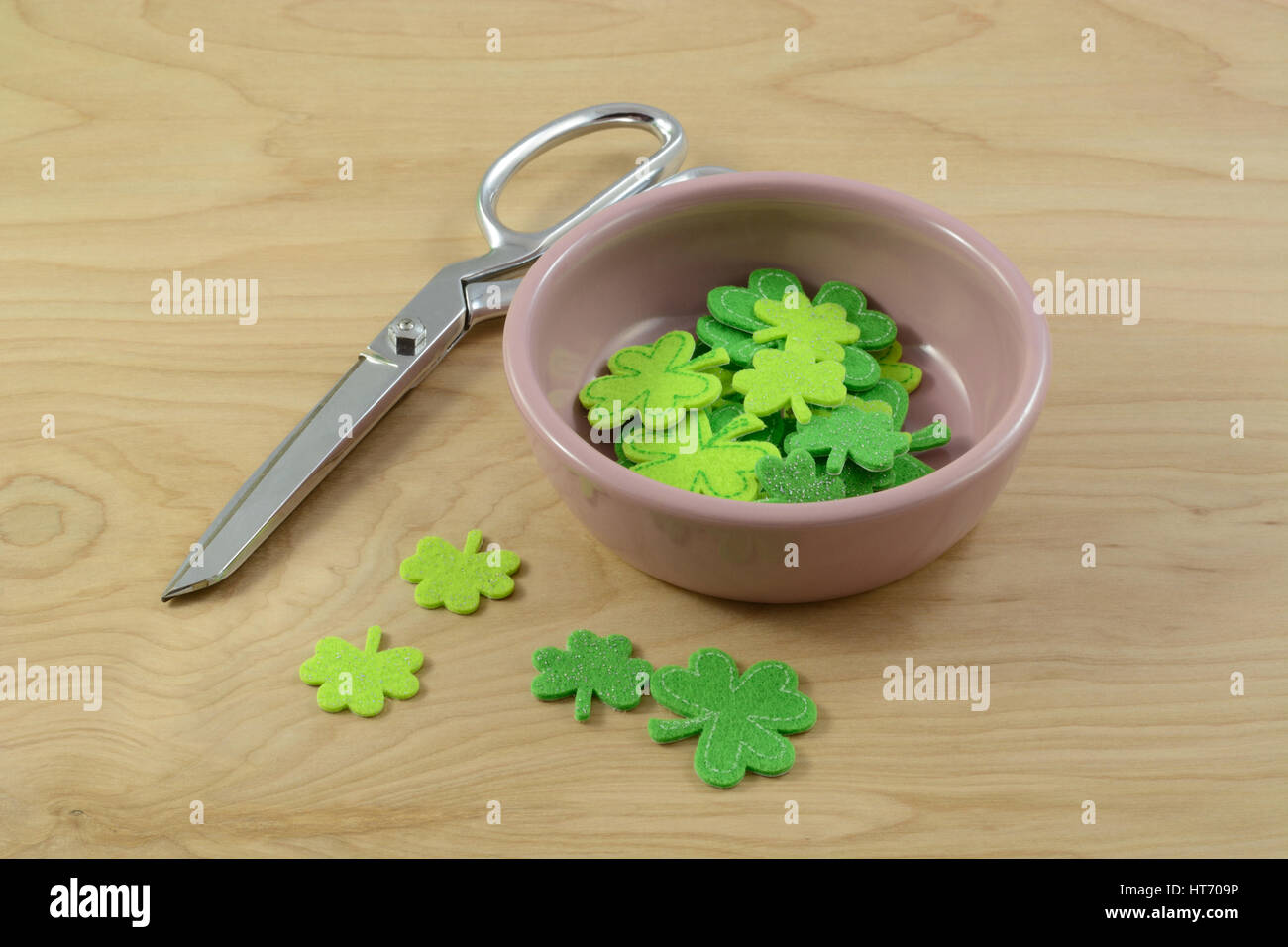 Saint Patrick's Day crafting project with green felt shamrocks and scissors  Save Download Preview Saint Patrick's - Stock Image