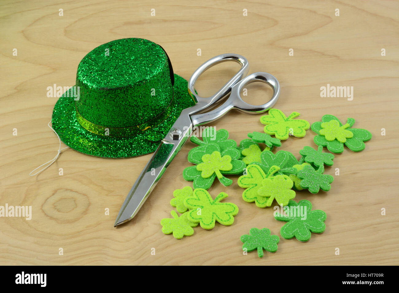 St. Patrick's Day crafting project with green hat and shamrocks and scissors Stock Photo