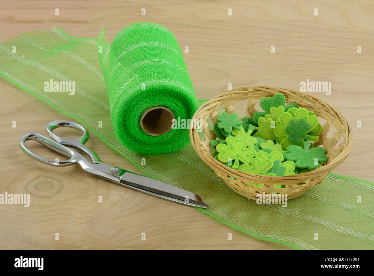Crafting Project for Saint Patrick's Day with green ribbon and shamrocks - Stock Image