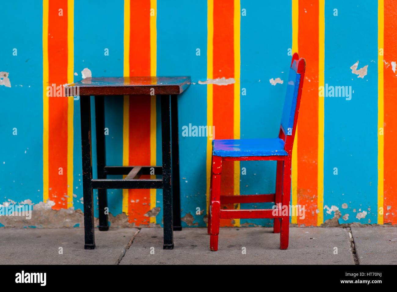 A wooden table with a cowhide chair are seen in front of the ...