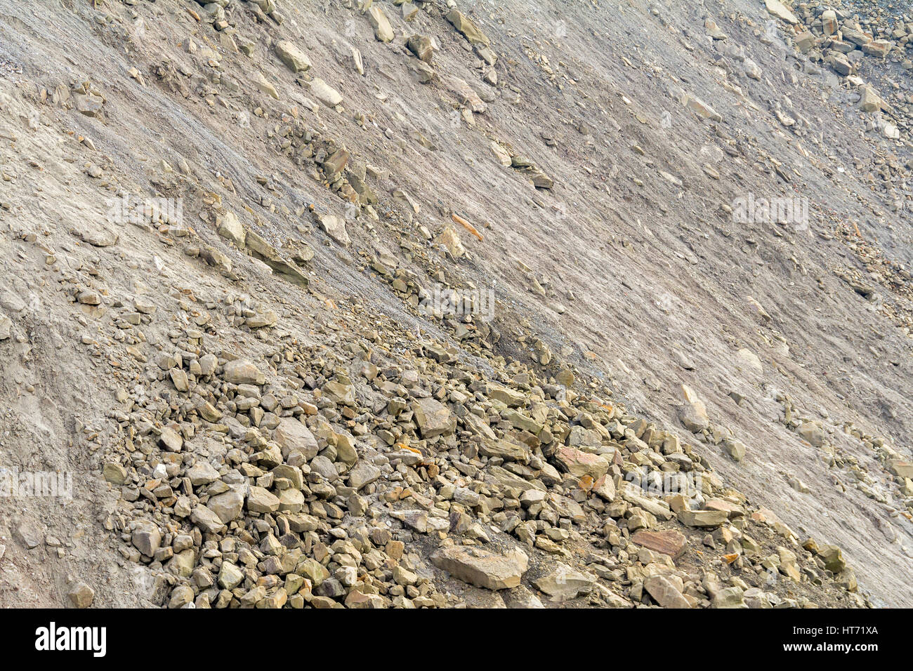 full frame shot of a hill slope with lots of stones and pebbles Stock Photo