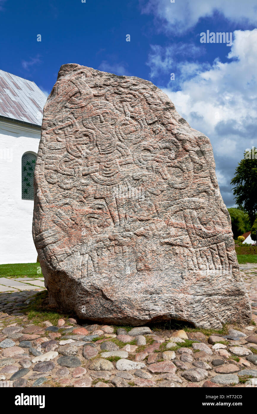 Jelling, Denmark. The figure of Christ on the large Jelling rune stone  raised by King Harald Bluetooth in the 960s. - Stock Image
