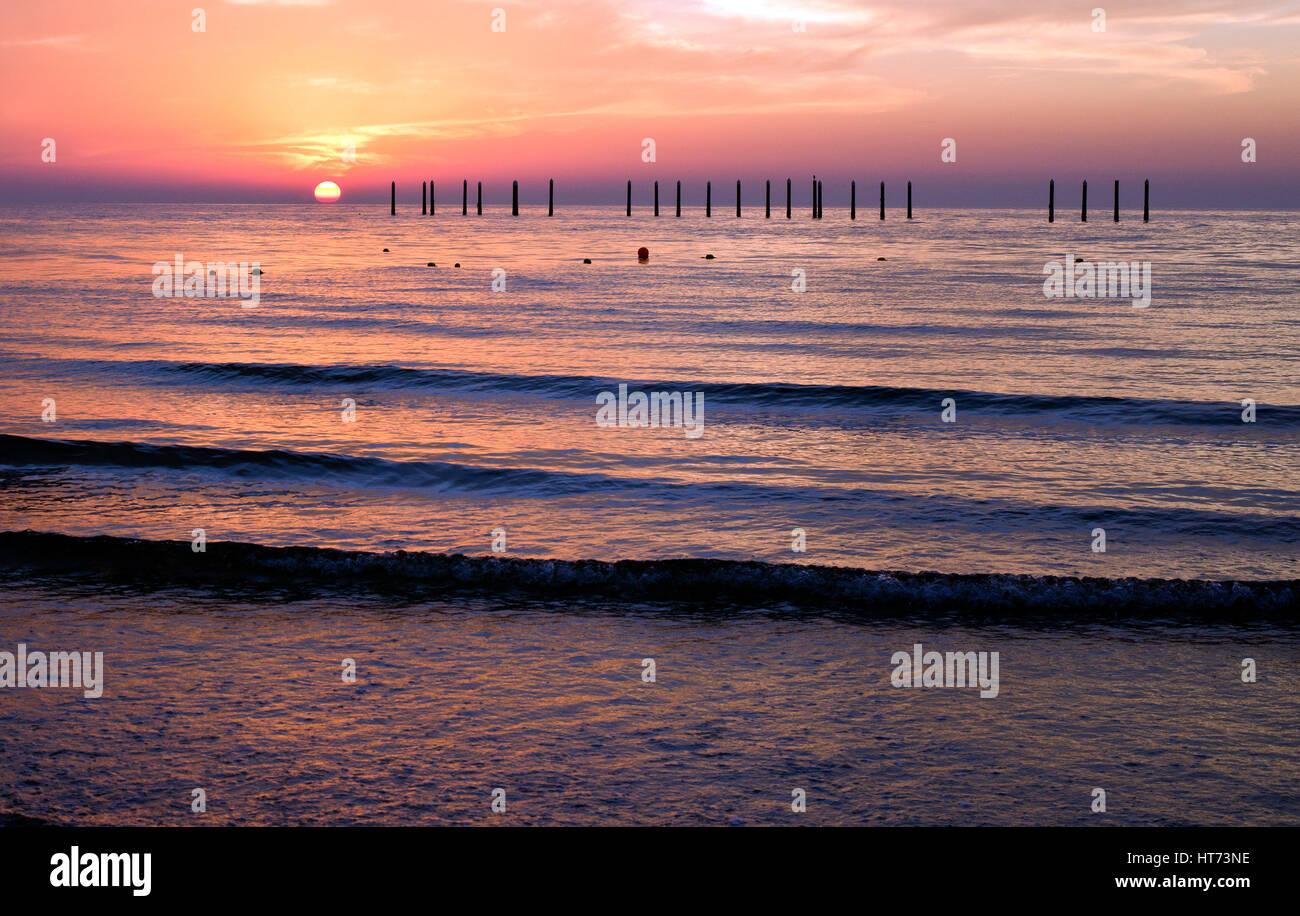 Sunset over the Persian gulf from the Ajman beach, UAE - Stock Image