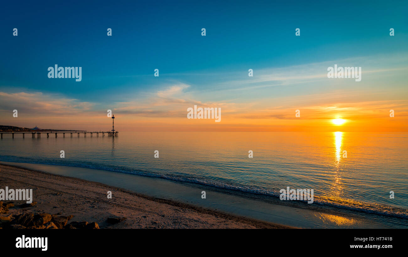 Sunset over the ocean viewed from Brighton Beach, South Australia - Stock Image