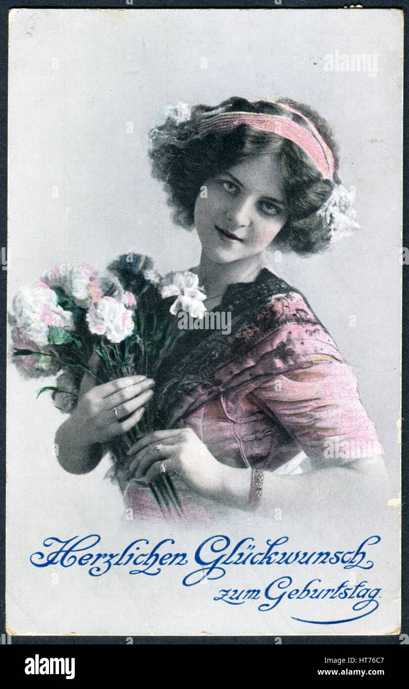 A Greeting Postcard Printed In Germany Shows Beautiful Woman With Bouquet Of Flowers