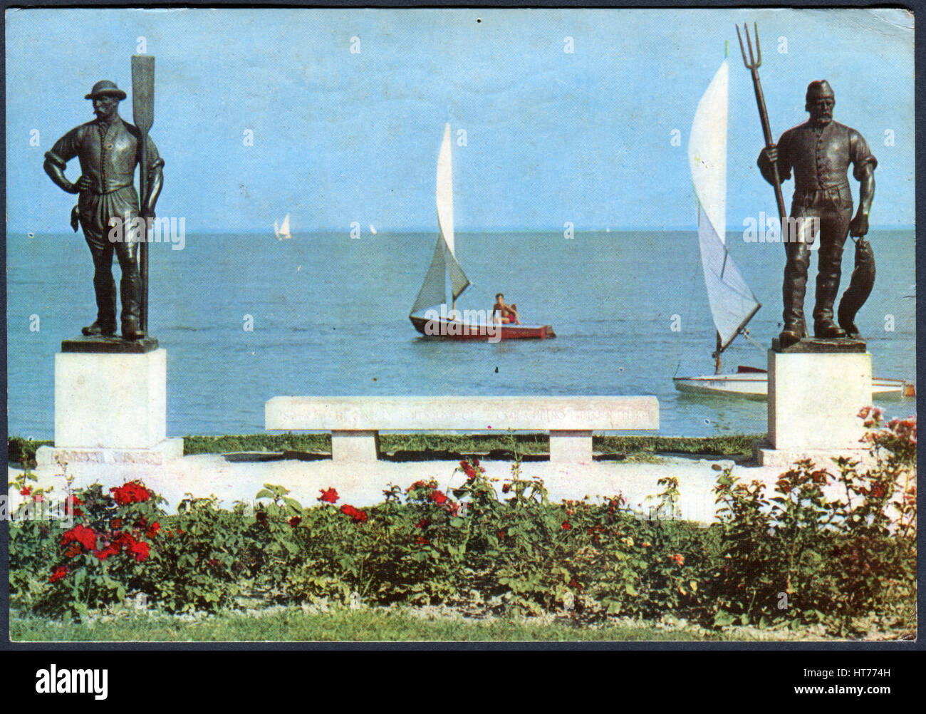 HUNGARY - CIRCA 1969: A postcard printed in Hungary, depicts a monument on Lake Balaton, 'Ferry-man' and - Stock Image