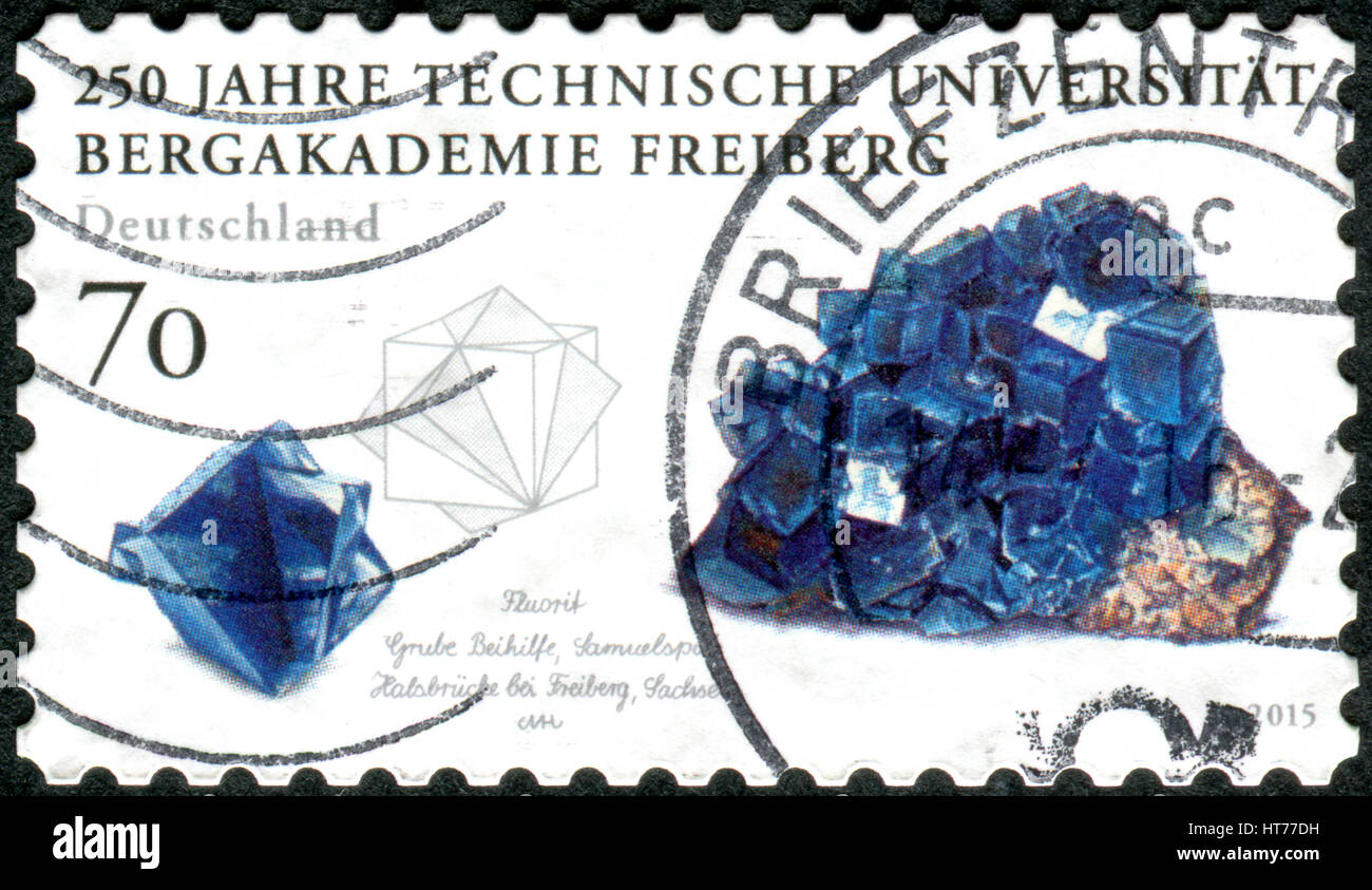 GERMANY - CIRCA 2015: A stamp printed in Germany, dedicated to the Mining Academy in Freiberg, shows a Fluorite, - Stock Image