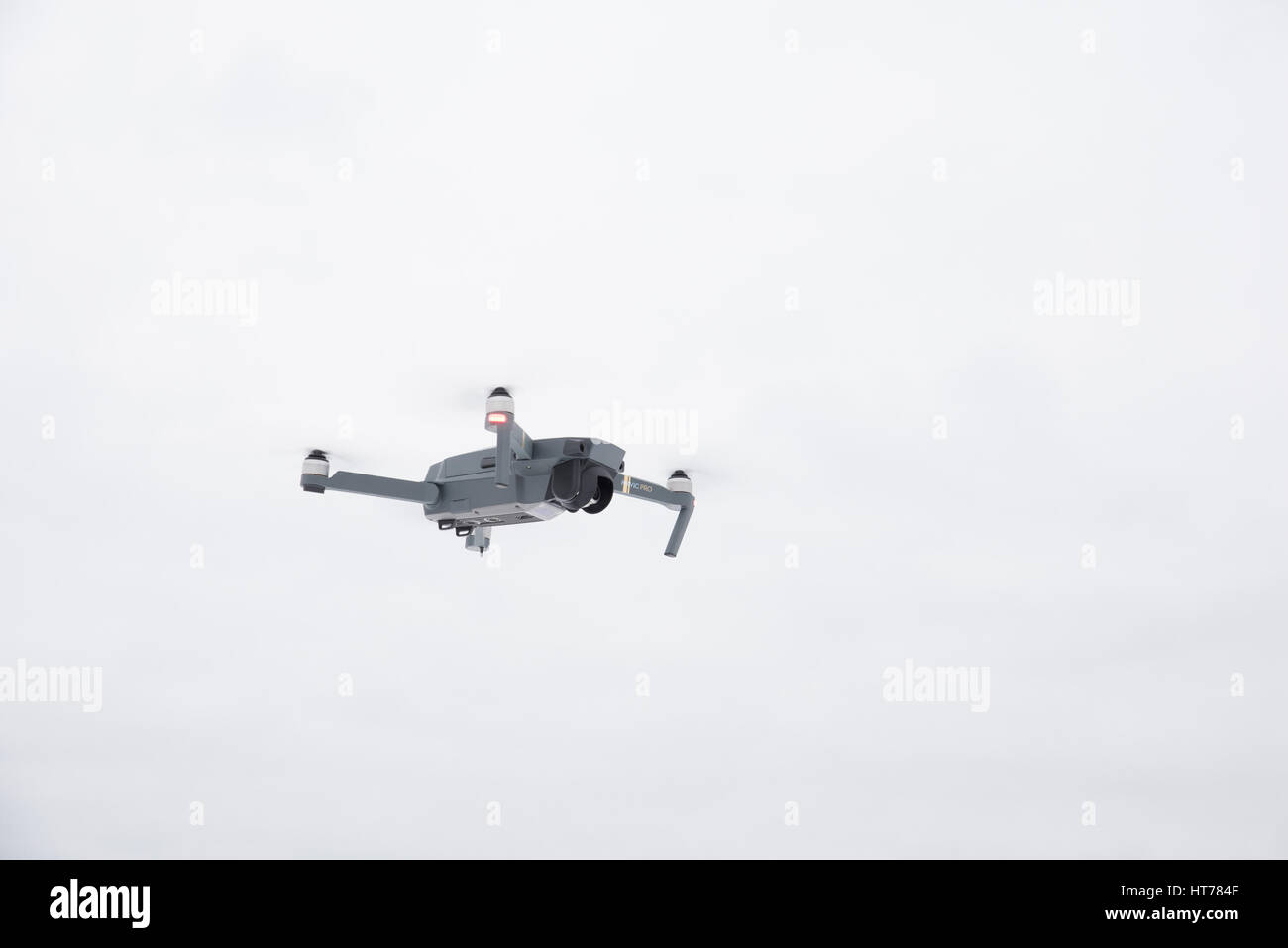 DJI Mavic Pro drone: Latvia March 8, 2017. Closeup of flying drone. Background of the blue sky. One of the most - Stock Image