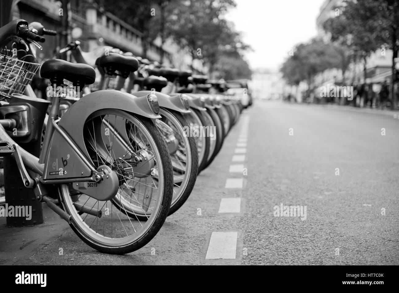 Bicycles on street in Paris Stock Photo