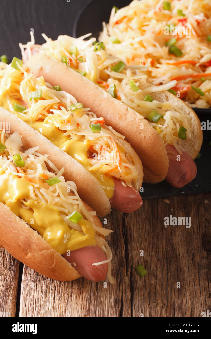 delicious hot dog with sausage sour cabbage and mustard. Black Bedroom Furniture Sets. Home Design Ideas