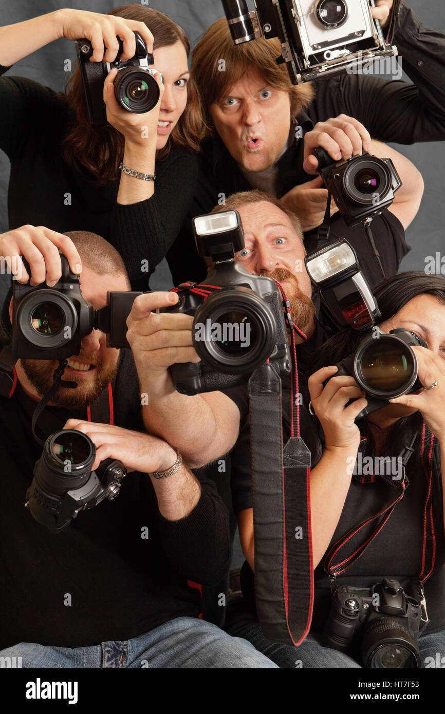 Photo of paparazzi fighting for space to take photos. - Stock Image