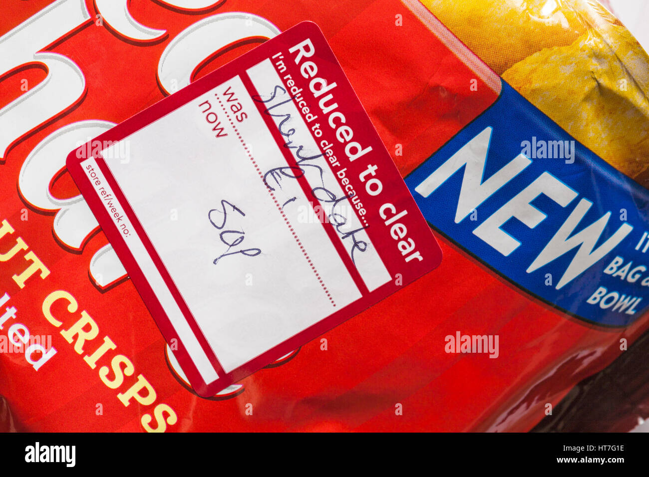 Reduced to clear sticker I'm reduced to clear because short date on packet of New Walkers Tear n Share thicker - Stock Image