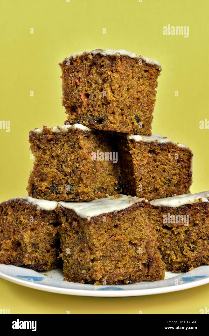 Home made carrot cake piled on plate - Stock Image