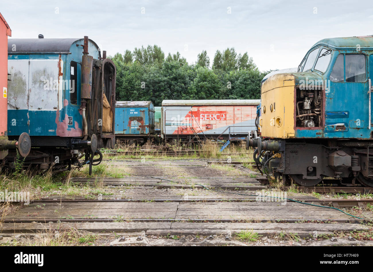Old rolling stock including a diesel locomotive and railway carriages at Nottingham Transport Heritage Centre, England, - Stock Image