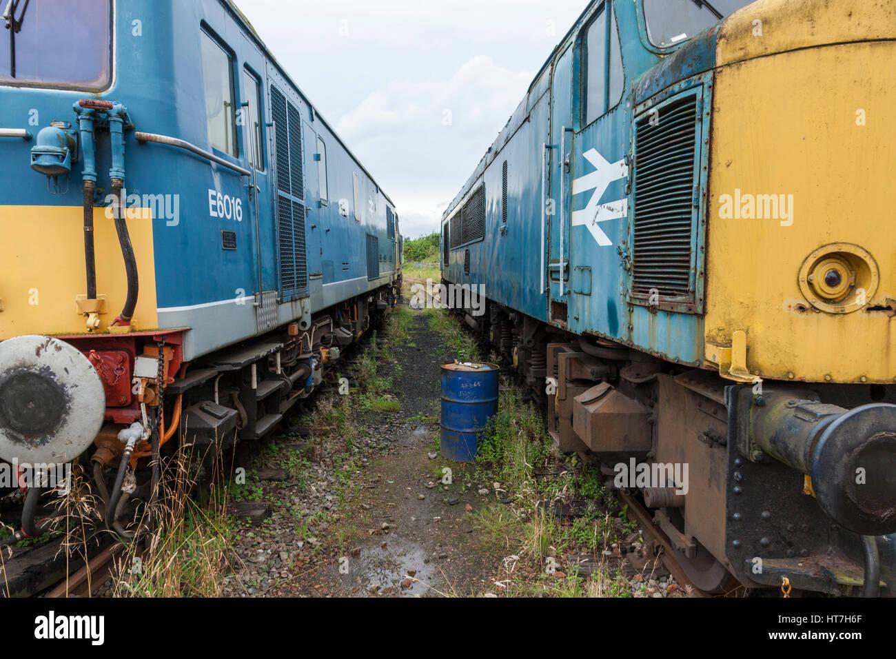 Between two old diesel locomotives awaiting restoration at Nottingham Transport Heritage Centre, England, UK Stock Photo