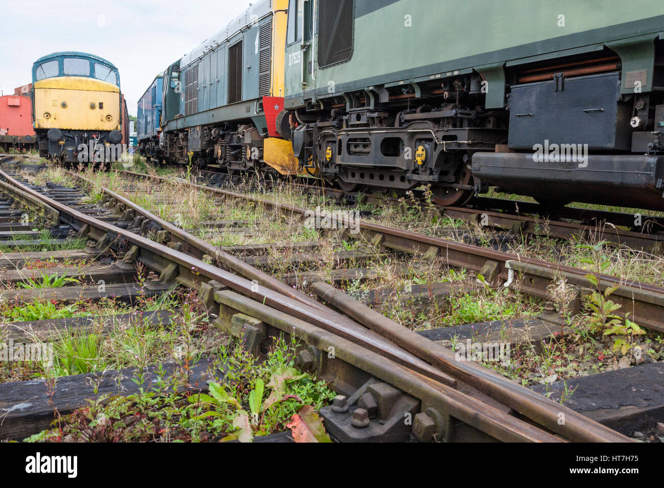 Several old diesel locomotives awaiting restoration at Nottingham Transport Heritage Centre, Ruddington, Nottinghamshire, - Stock Image