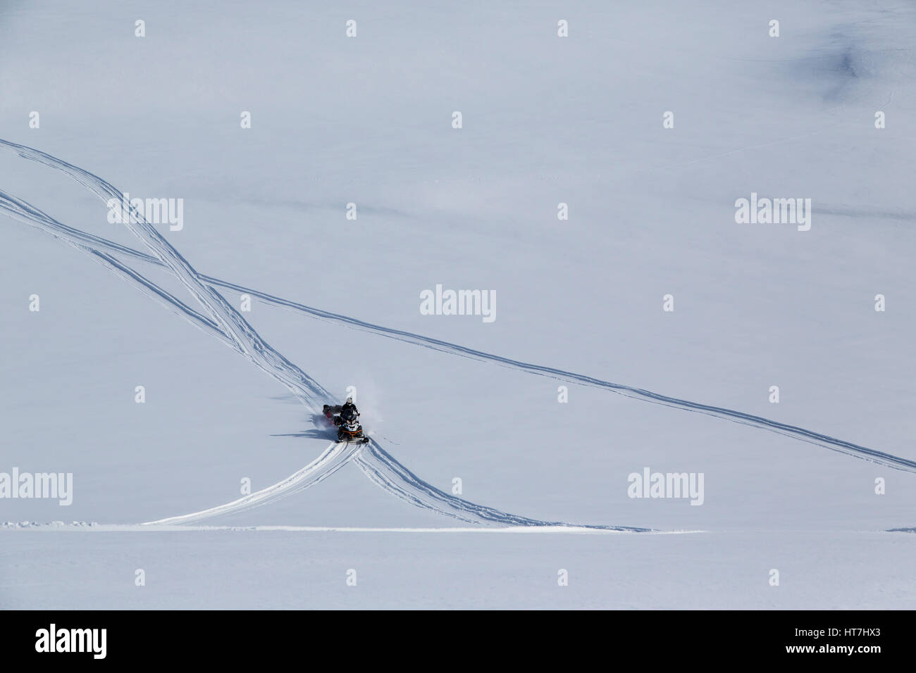 Snowmobile Expedition Crossing The Vast Plains Of Jameson Land - Stock Image