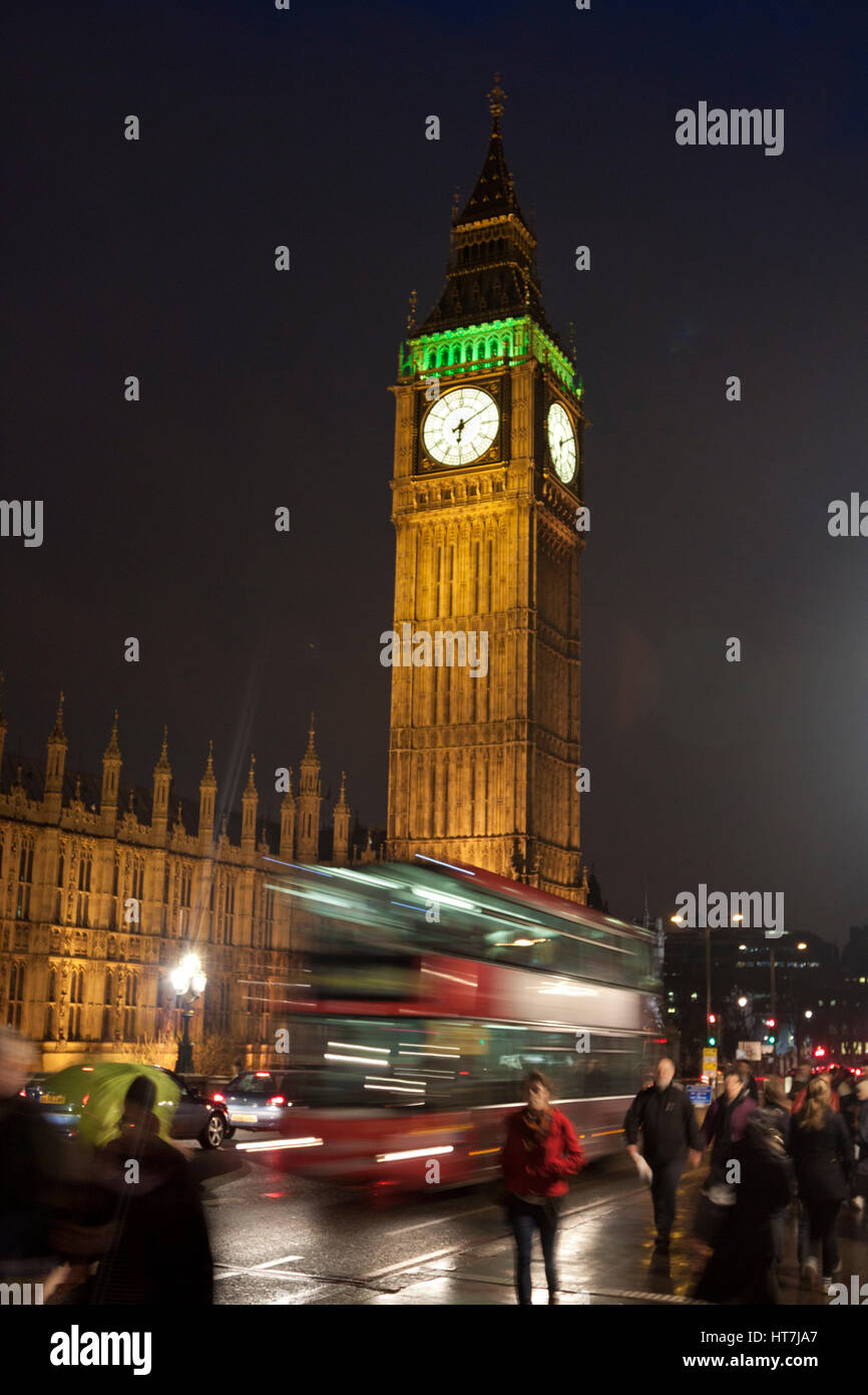 A Double Decker Bus Drives Over The Westminster Bridge In London, England - Stock Image