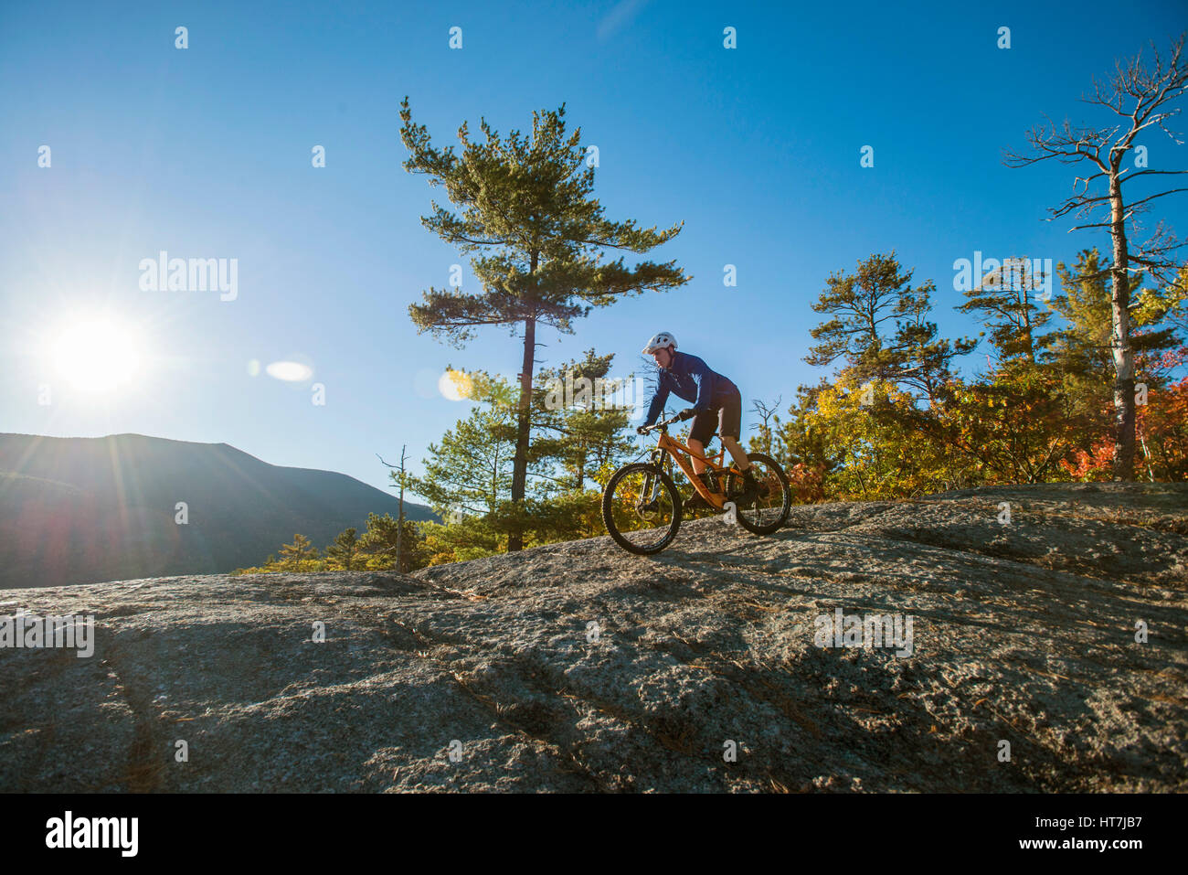 Alex Leich On The Bare Granite Slabs Of Whitehorse Ledge In North Conway, New Hampshire - Stock Image