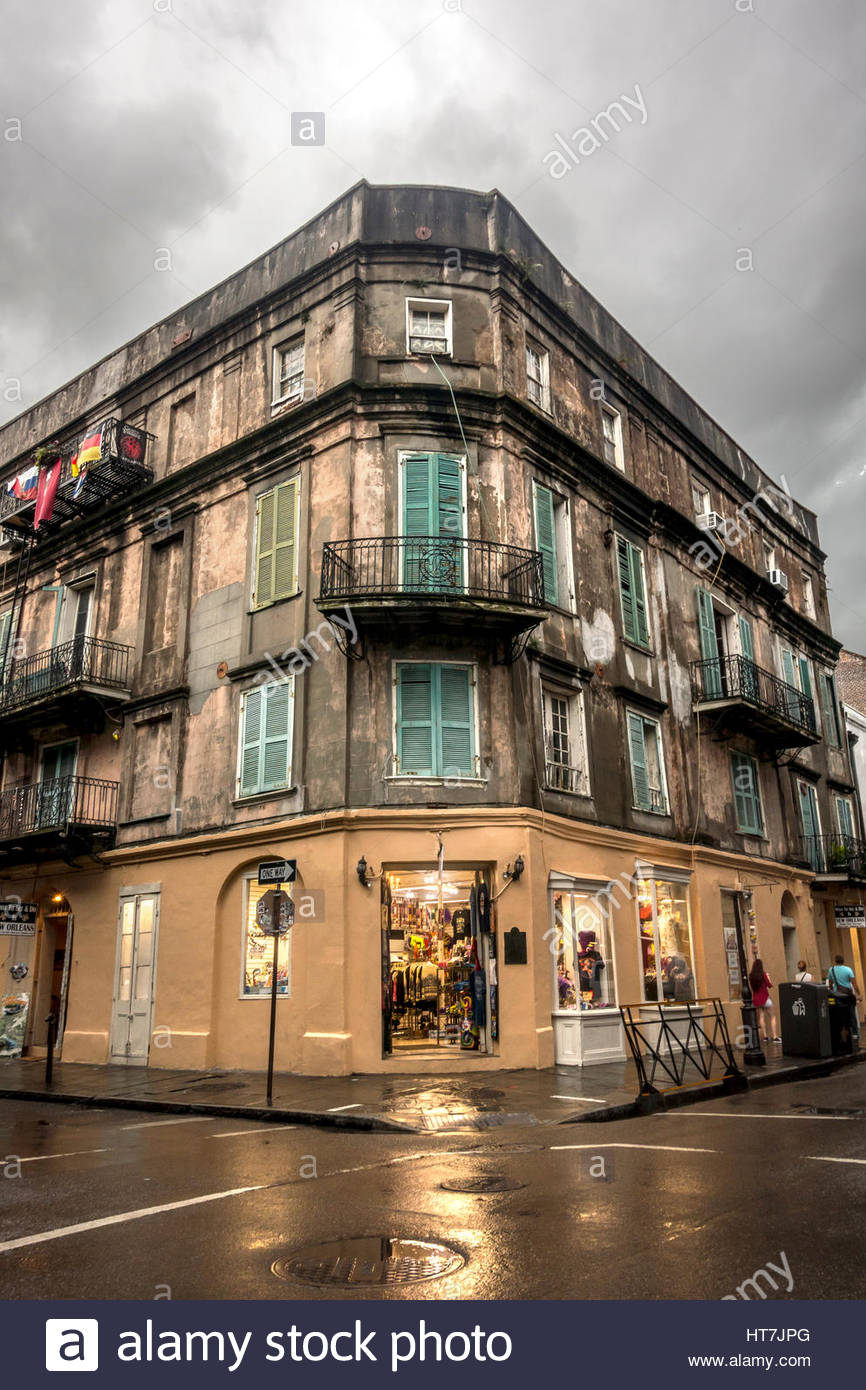 Light From A Storefront Spills Out Onto A Wet Street In The French Quarter Of New Orleans, Louisiana, Usa Stock Photo