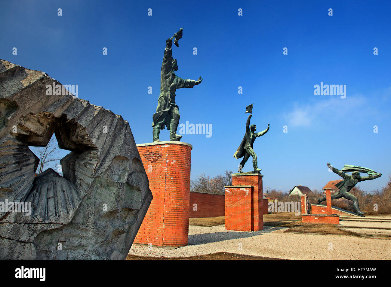 Statues of the Communist Era (examples of the 'socialist reallism') in the Memento Park, an open-air museum - Stock Image