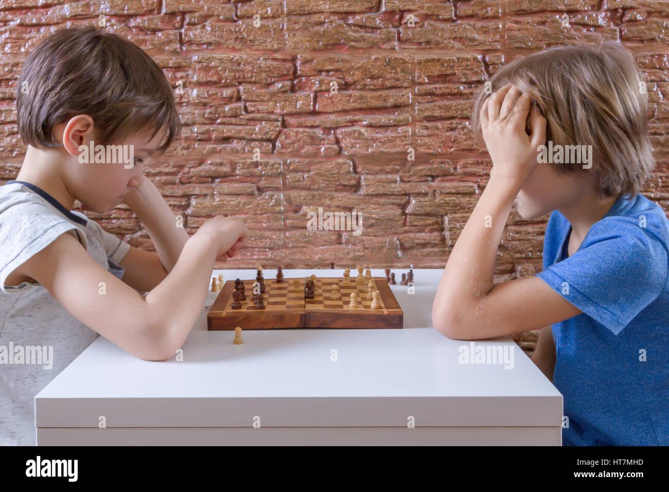Kids playing chess Stock Photo