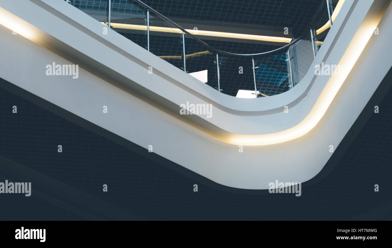 Contemporary spaces of public place. Mezzanine with glass balcony railing. Ceiling lighting in a modern building. Stock Photo