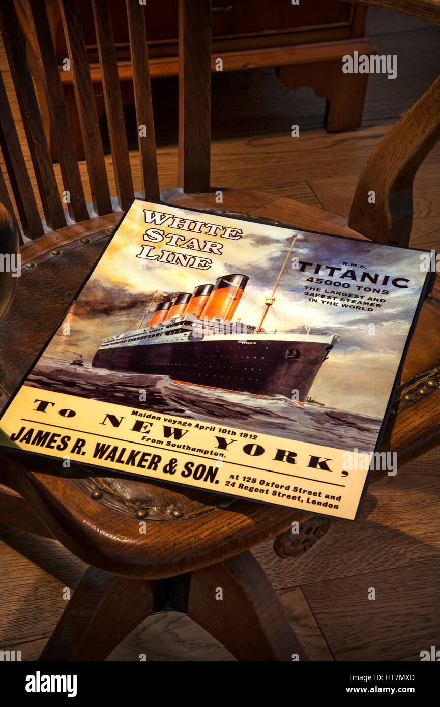Vintage 'Titanic' poster left on old wooden bosun's chair, promoting the tragic fateful maiden voyage - Stock Image