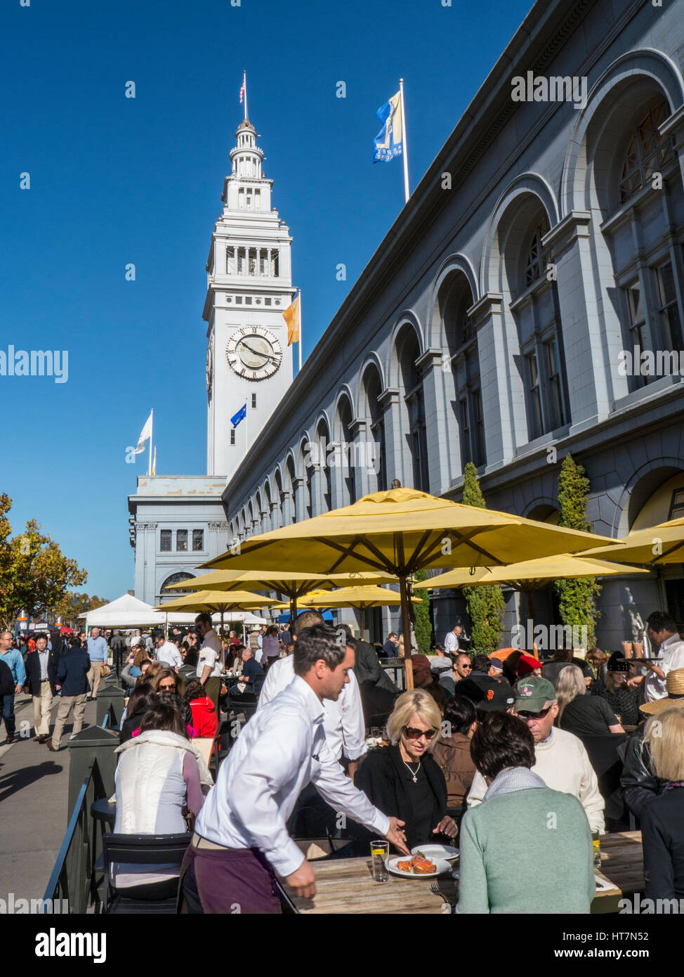 Alfresco restaurant dining on Embarcadero Ferry Building Farmers Market day San Francisco California USA - Stock Image