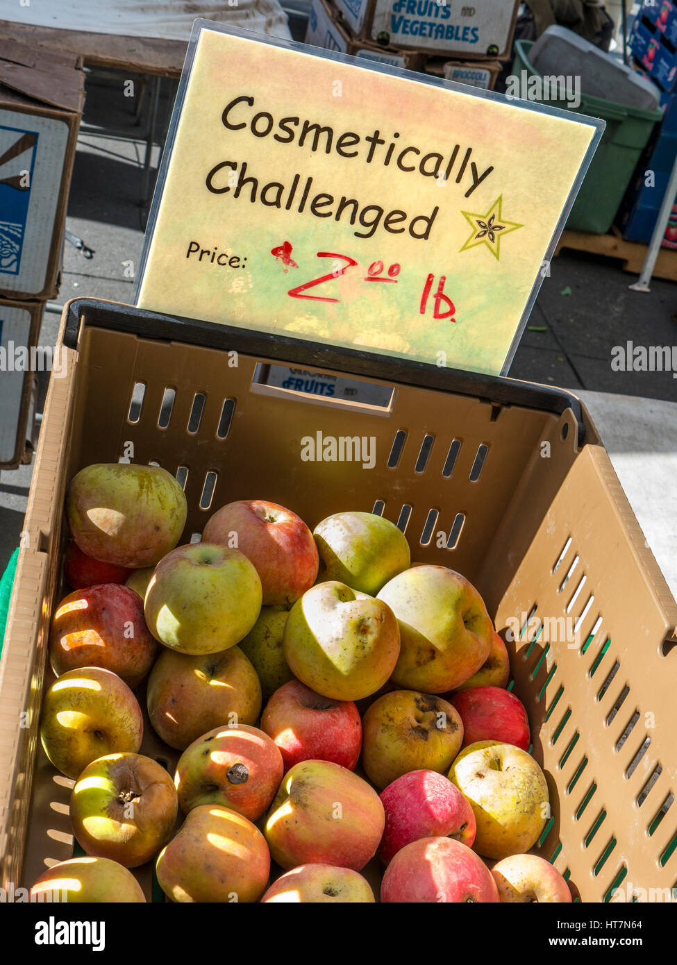 Cosmetically challenged apples on sale at Farmers Market Embarcadero San Francisco California USA - Stock Image
