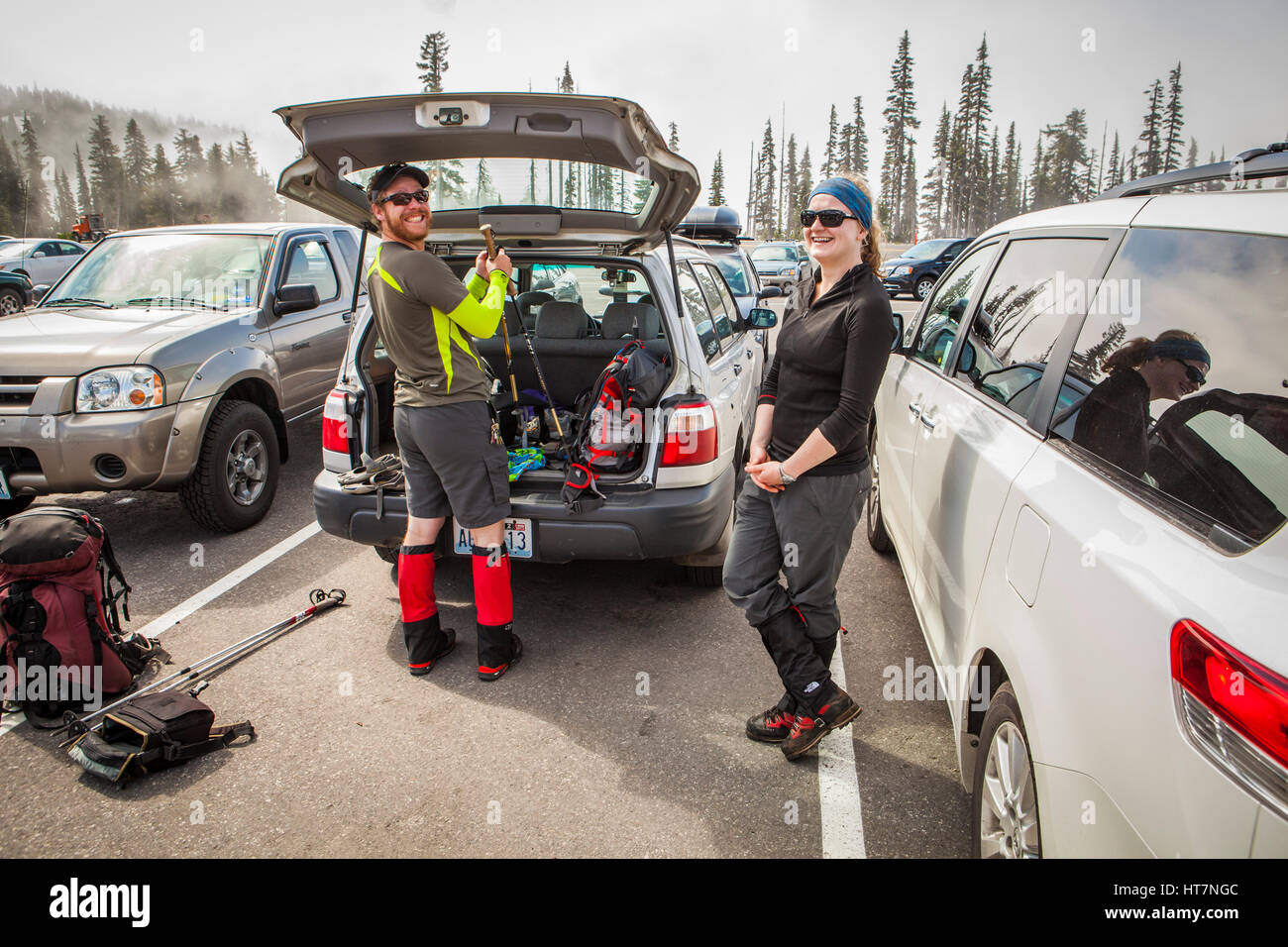 Hikers in the parking lot at Paradise Lodge in Mount Rainier National Park getting ready for a hike up the mountain. - Stock Image