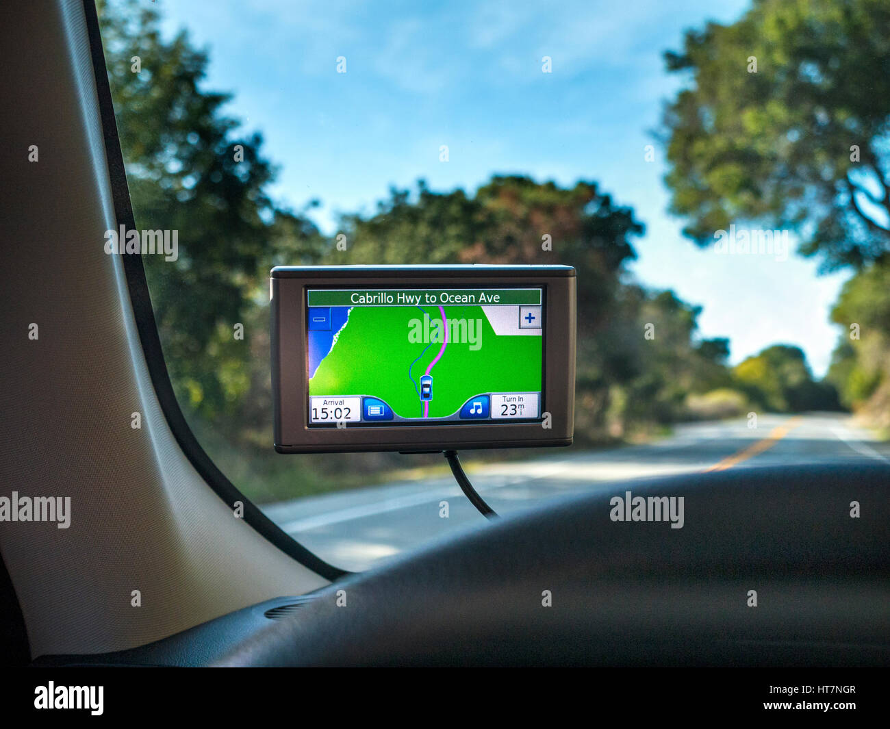 In-Car Satellite Navigation screen displaying route Cabrillo Highway to Ocean Avenue Pacific Grove California USA - Stock Image