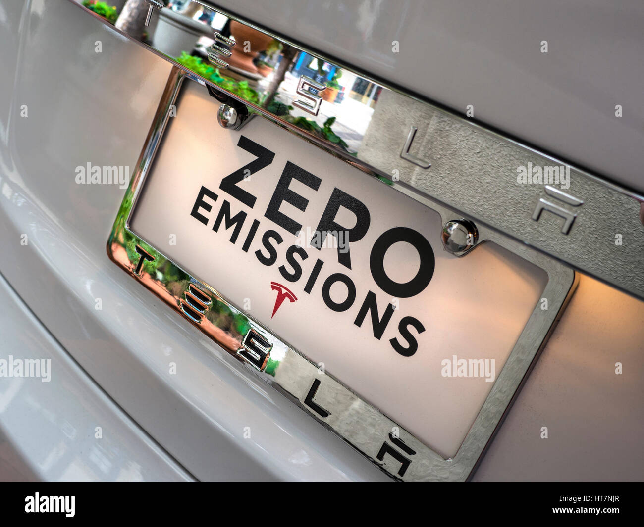 Zero emissions display plate on latest Tesla Model S an all electric powered stylish sports car with 300 miles range - Stock Image