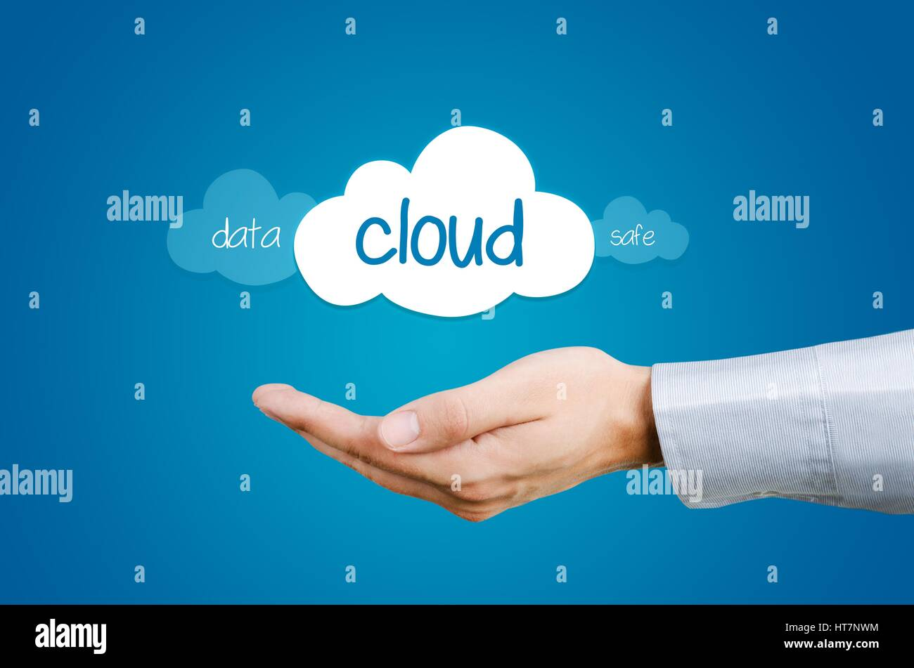 Cloud computing composition - hand and clouds with data and safe words Stock Photo