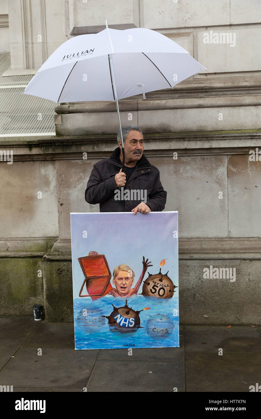 London, UK. 8th Mar, 2017. Satirical artist, Kaya Mar outside Downing Street with his new Budget Day painting of - Stock Image