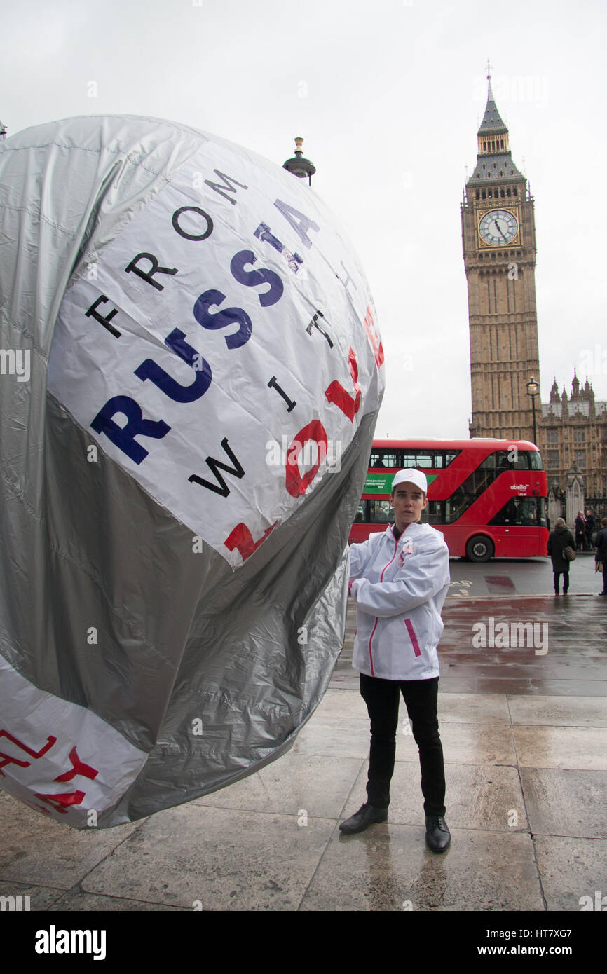 London, UK. 8th Mar, 2017. A group of men inflate a balloon with the inscription 'From Russia With Love Make - Stock Image