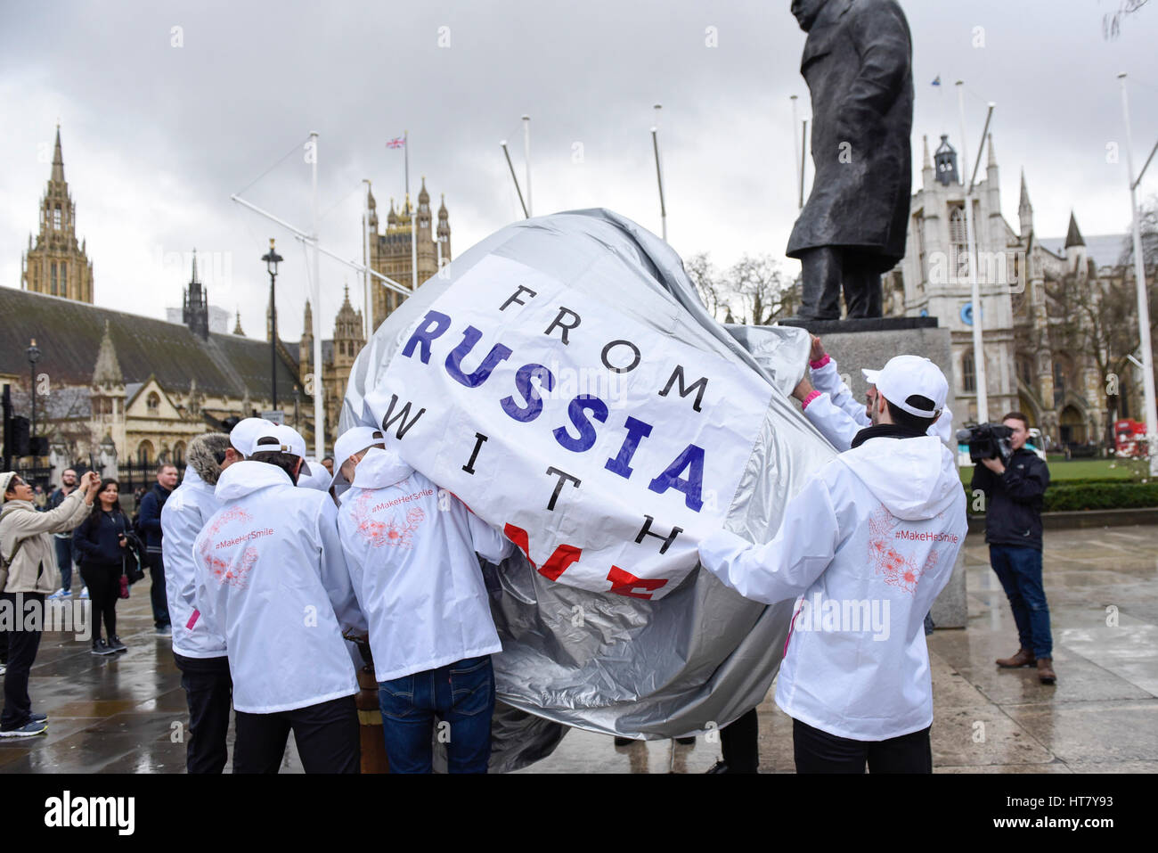 London, UK.  8 March 2017.  A flashmob takes place in Parliament Square as part of International Women's Day. - Stock Image