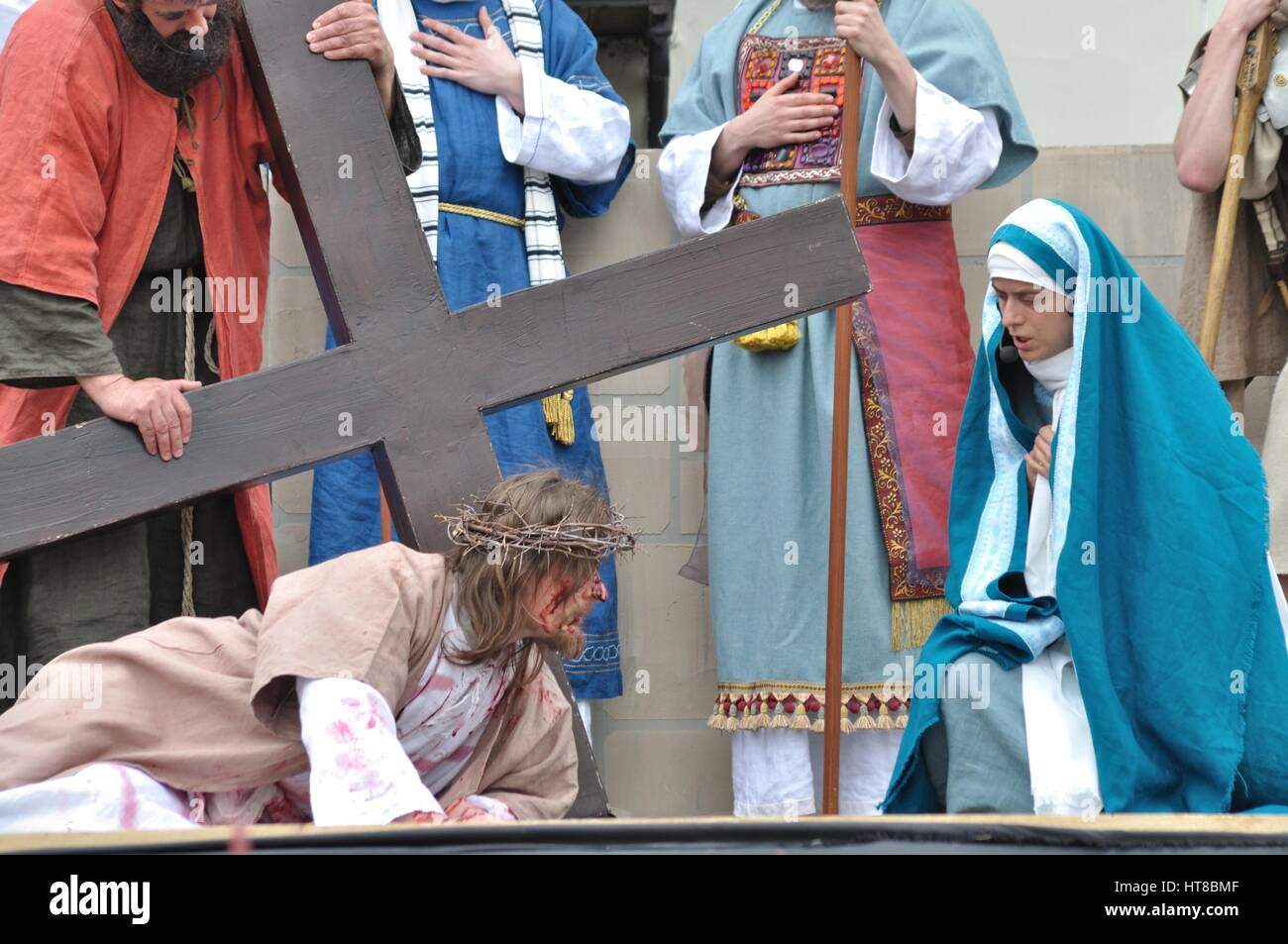 Jesus meets Veronica on the way to his crucifixion, during the street performances Mystery of the Passion. - Stock Image