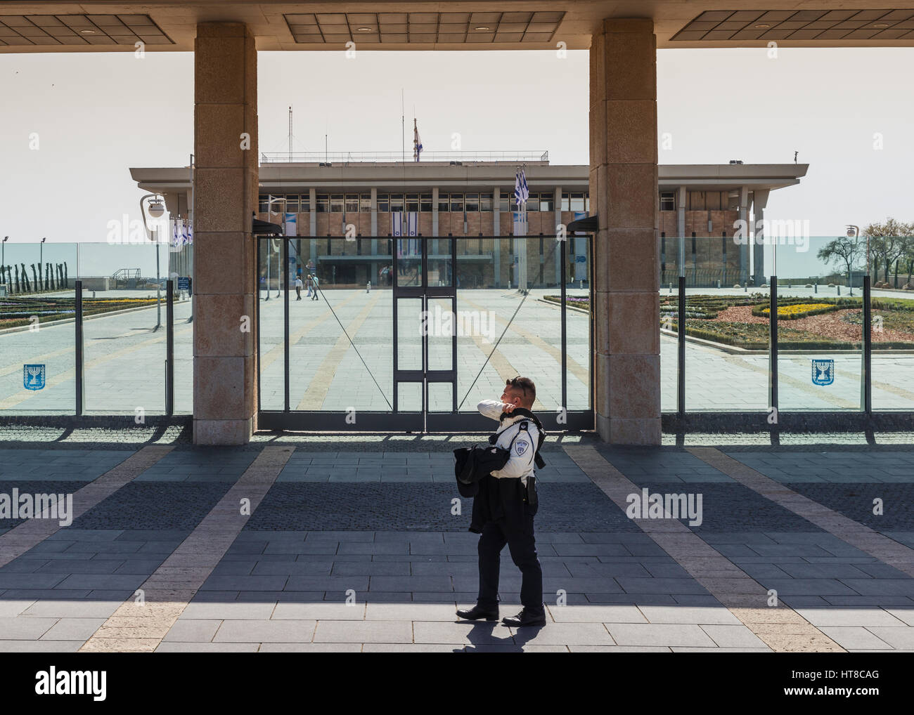 A guard in front of the Knesset which is Israel's Parliament building - Stock Image