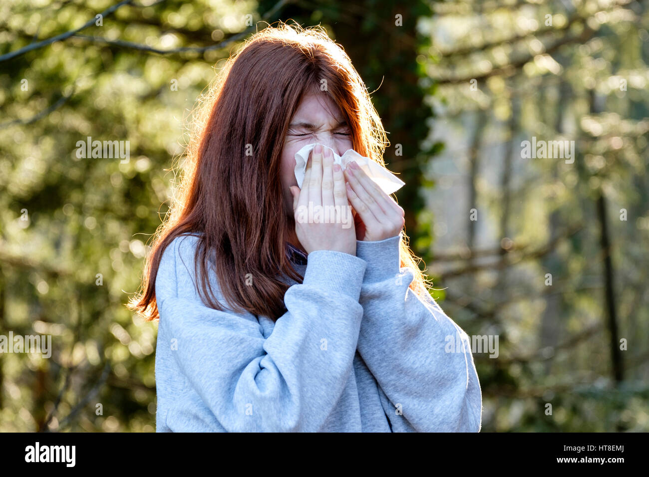 Teenager, girl wiping her nose, runny nose, allergy, Germany - Stock Image