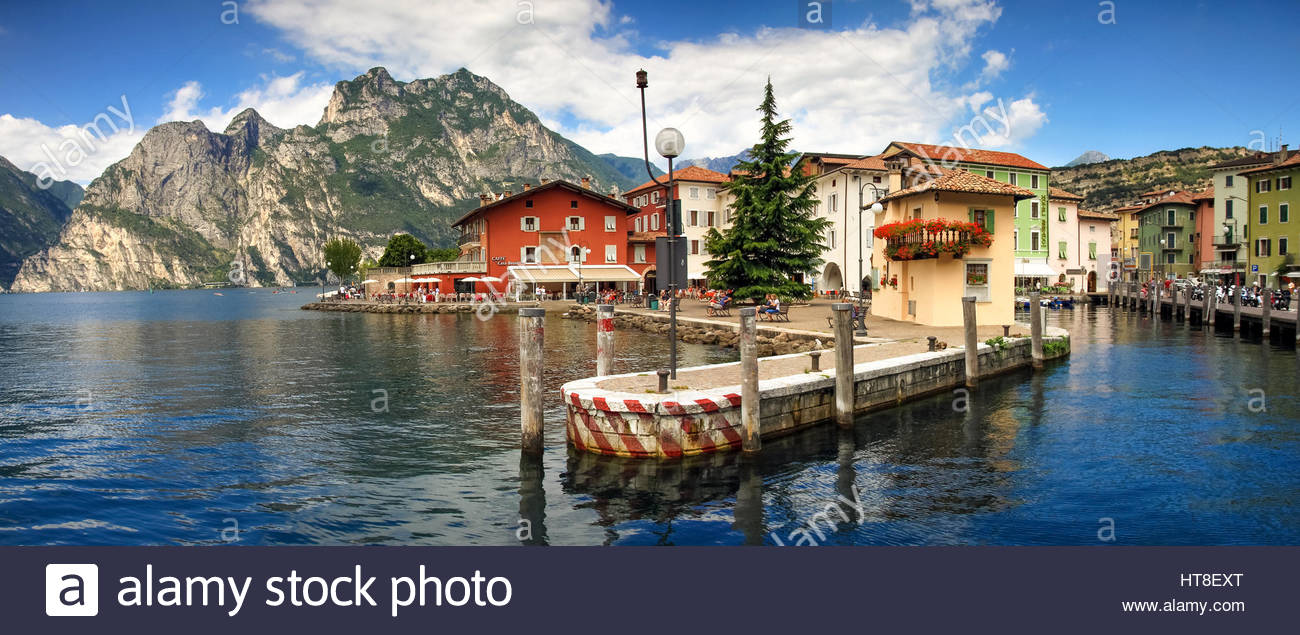 Beautiful Italian Village Town Torbole On Lakefront Of Lake Garda With Colorful Houses In Summer