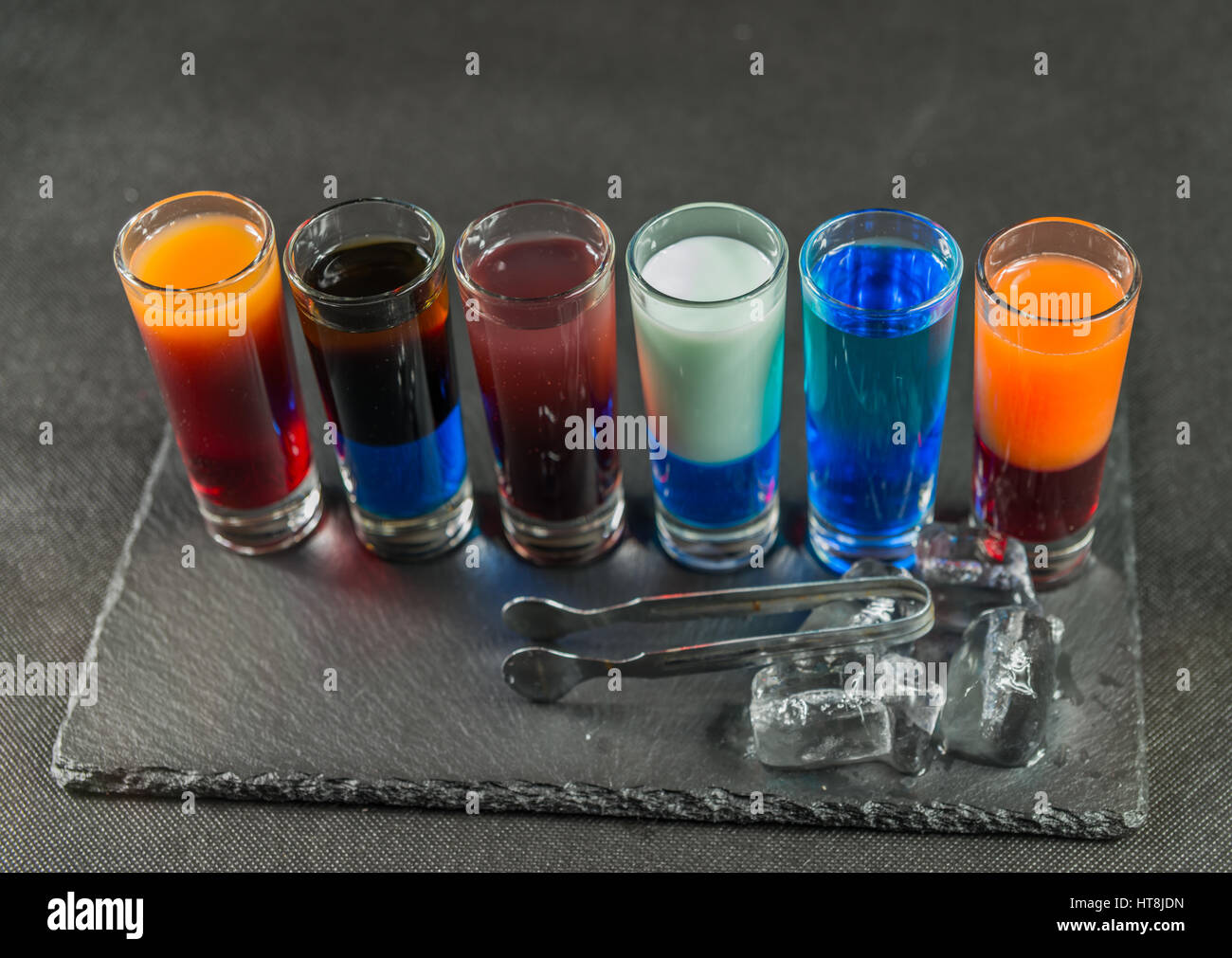 Right Side View On A Six Different Colored Shot Drinks Lined Up