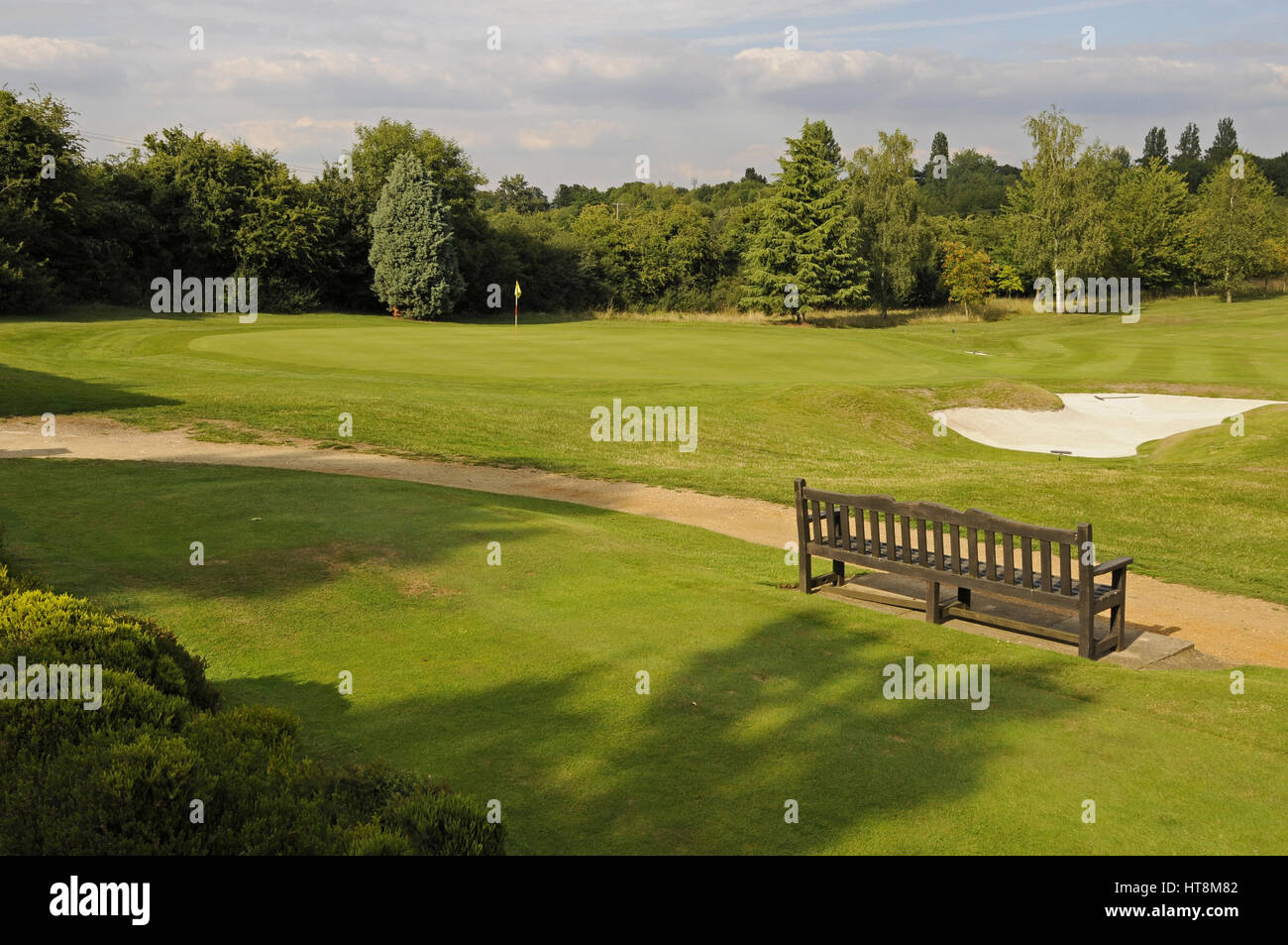 View over 13th Tee and bench to the 12th Green, Woodcote Park Golf Club, Coulsdon, Surrey, England Stock Photo