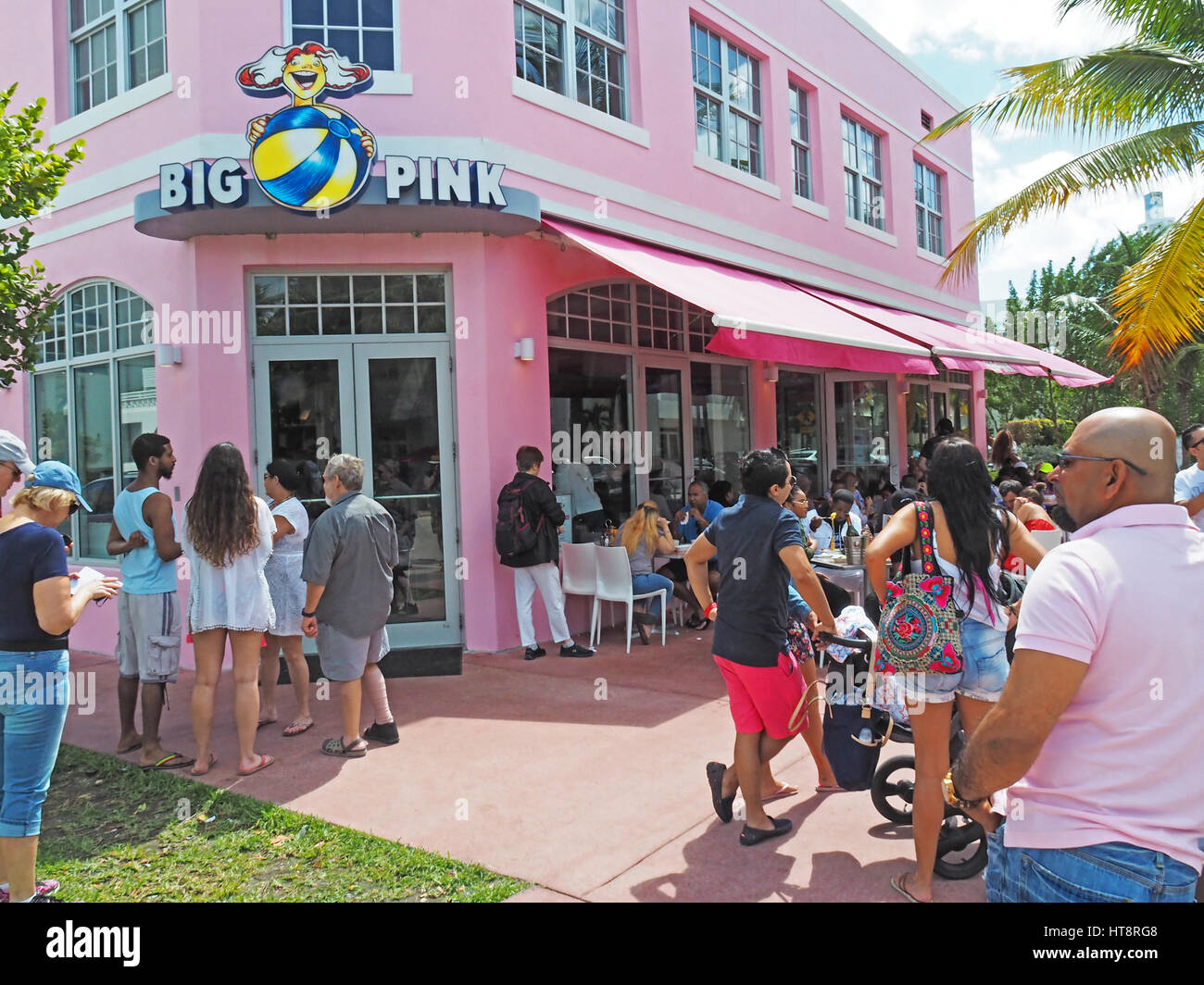 Customers waiting for tables at popular Big Pink restaurant in Miami's South Beach. - Stock Image