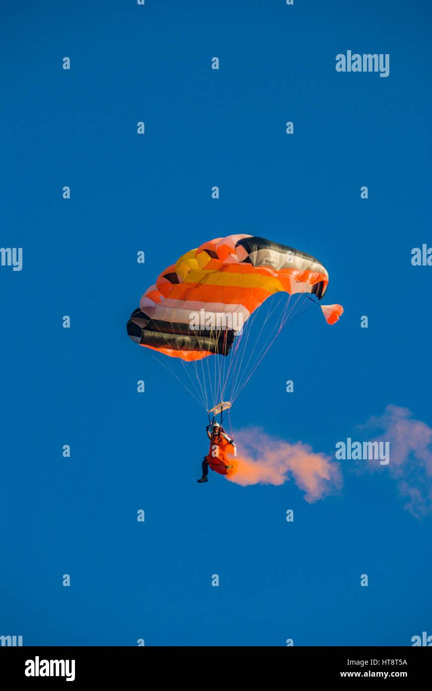 smoky skydiver performs acro show - Stock Image