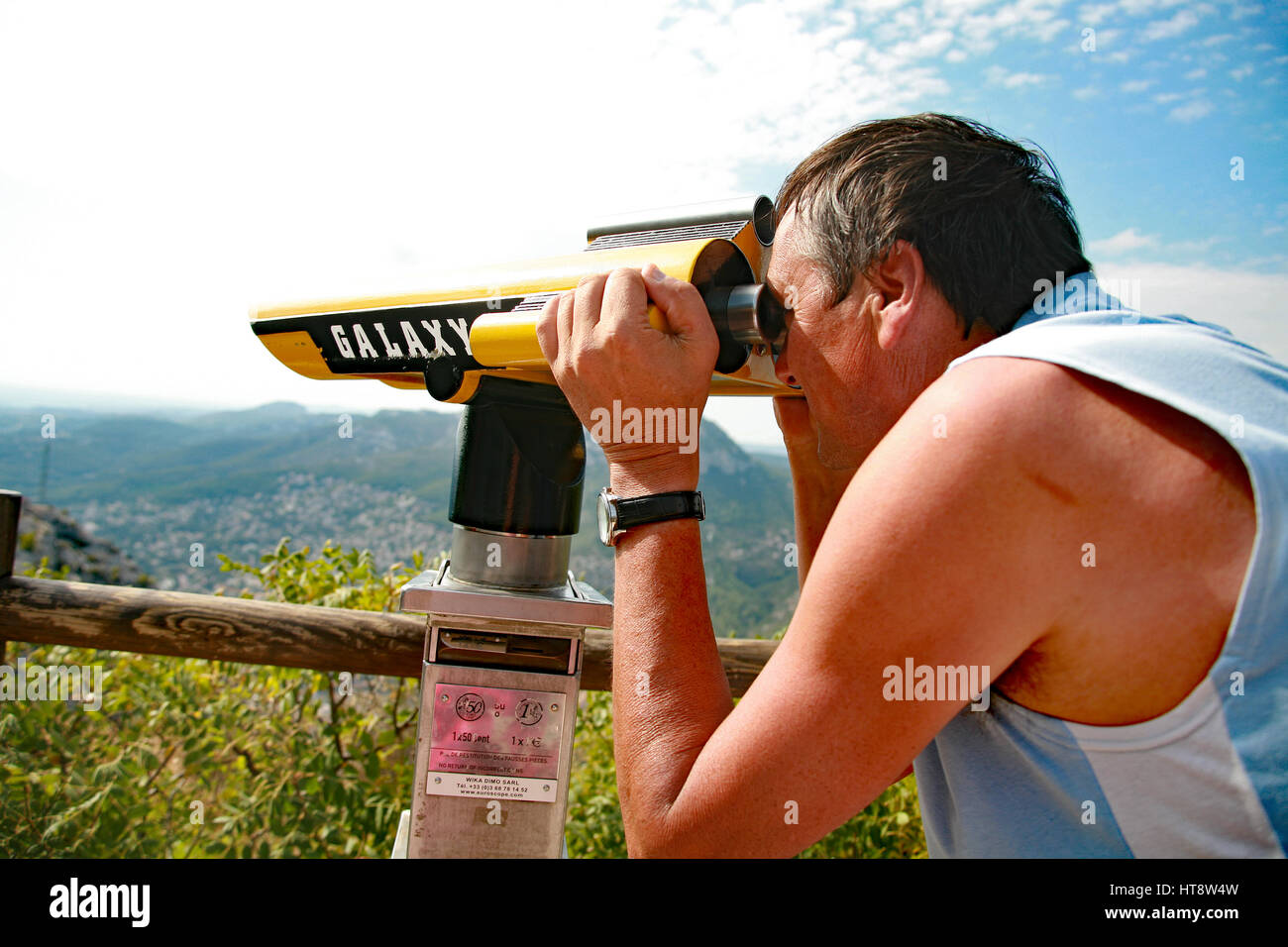 Man using a telescope South of France - Stock Image