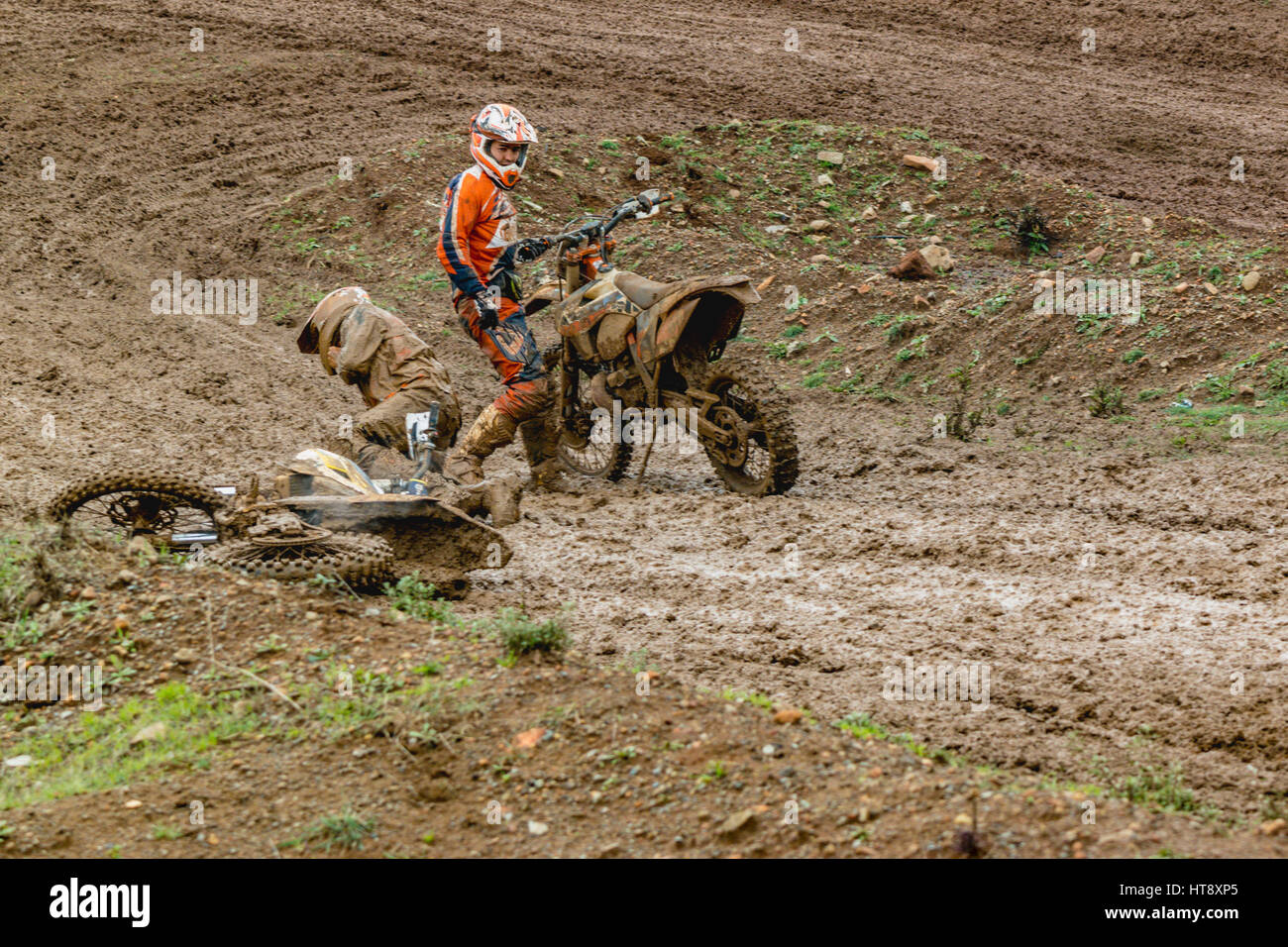 motocross accident in the mud - Stock Image